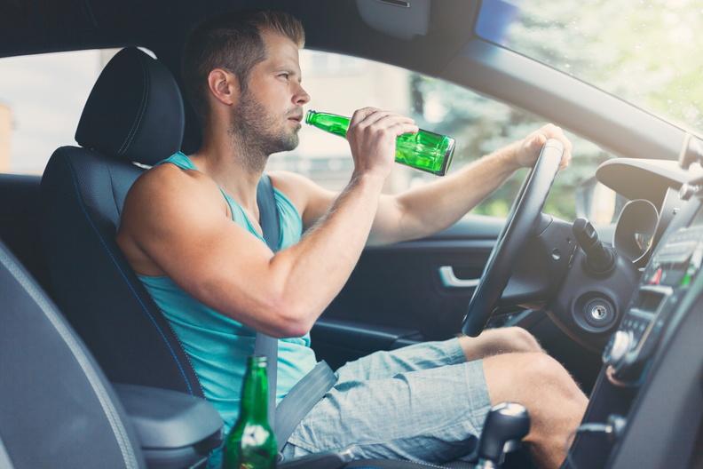 drunk-driver-behind-the-steering-wheel-of-a-car-HZYU3BT.jpg
